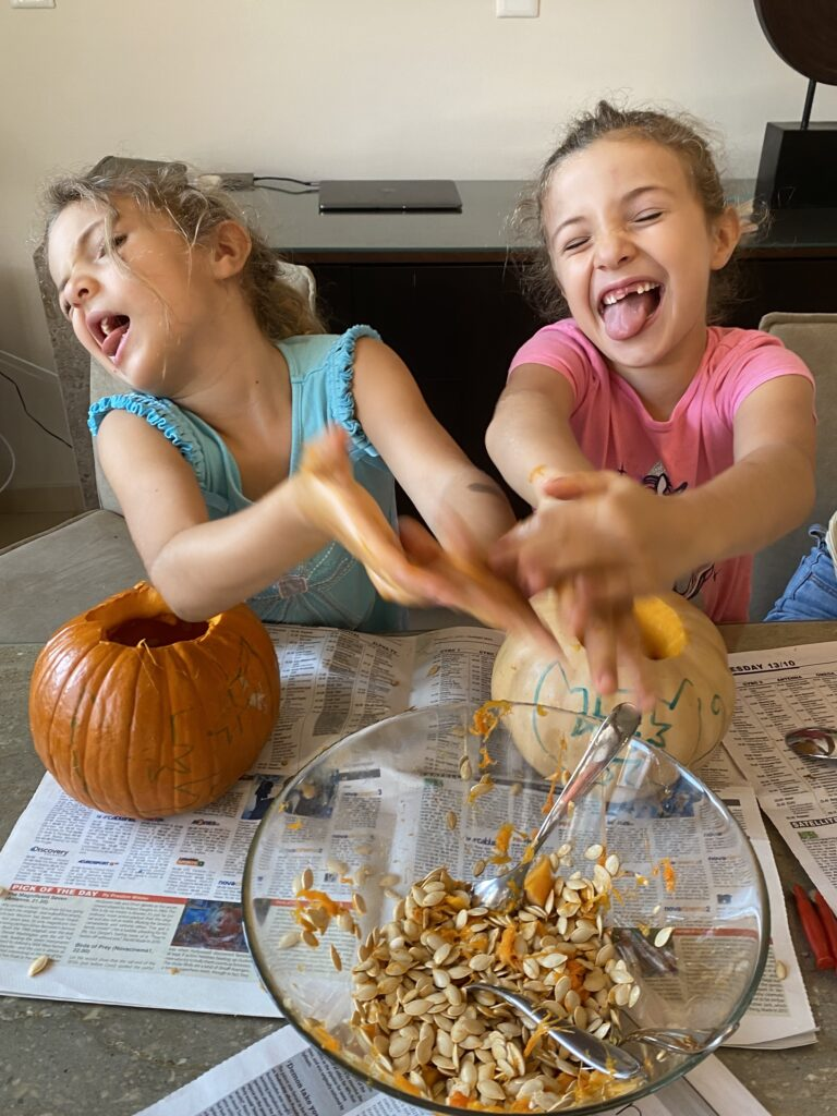 Scooping out the insides of a pumpkin.