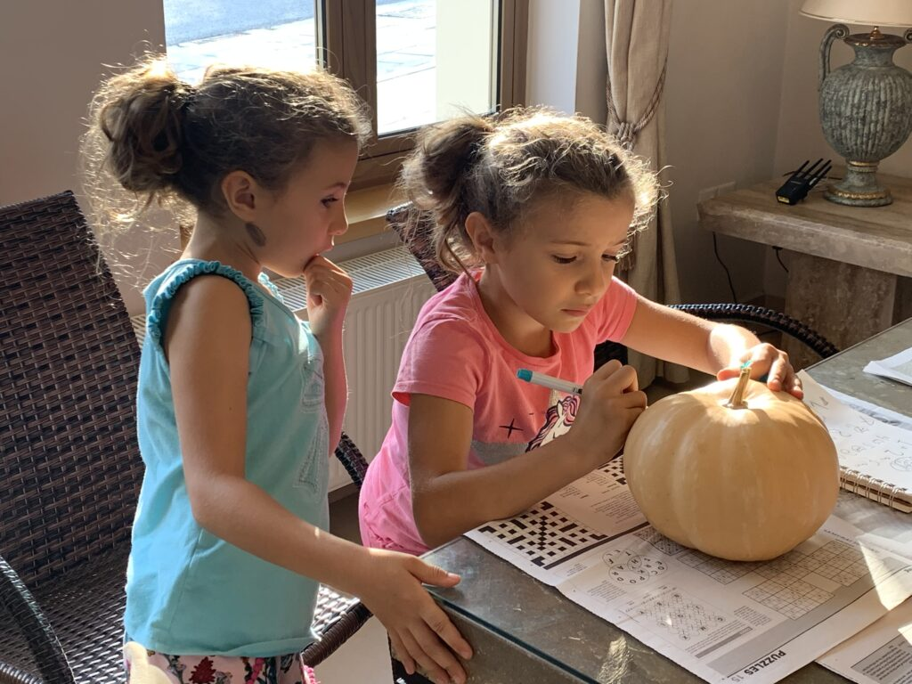 Drawing the Merkitty design on the front of our pumpkin.